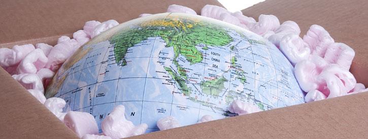 a globe inside a cardboard box, representing idaho international movers