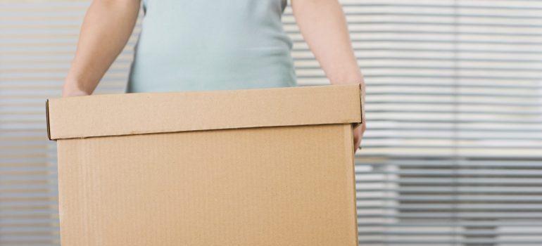 Woman holding box