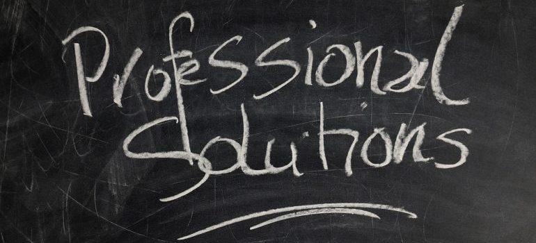 Professional Solutions written on a blackboard.