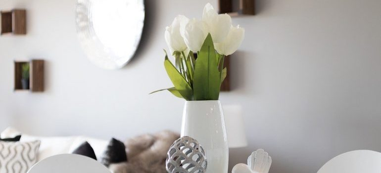 A white vase on the table.